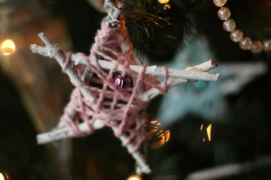 pink yarn wrapped twig star on tree