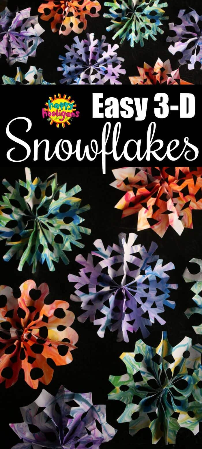 This is the easiest way to make 3D paper snowflakes. So easy even young kids can make them with little assistance. We marbleized our paper first with shaving cream and watercolours so our snowflakes would be colourful and gorgeous. Step by step tutorial and video for making these snowflakes is in the post. #HappyHooligans #PaperSnowflakes #PaperCrafts #SnowflakeCrafts #3DSnowflake #KidsCrafts #WinterCraftsForKids #FineMotorCrafts #DaycareCrafts #MarbleizingWithShavingCream #KidsArt #ArtForKids