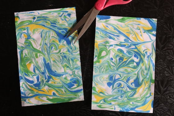 Marbled paper cut in half for snowflake craft