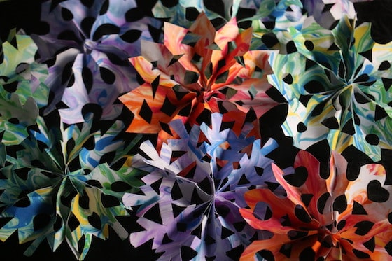 pile of colourful 3d paper snowflakes