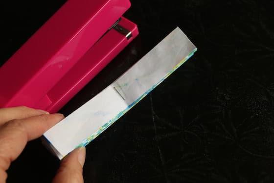 stapler and folded paper