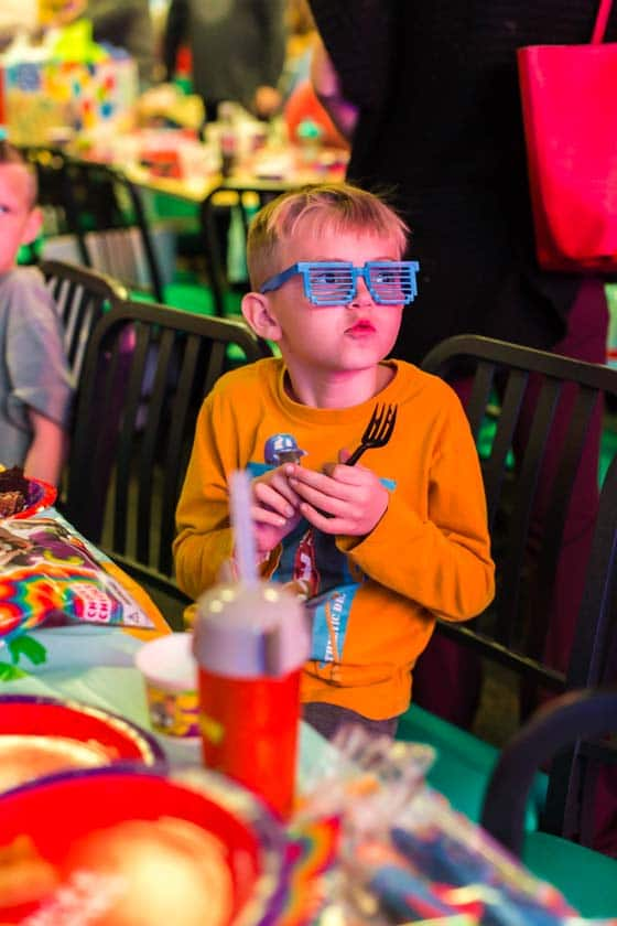Boy wearing sunglasses at Chuck E. Cheese's party