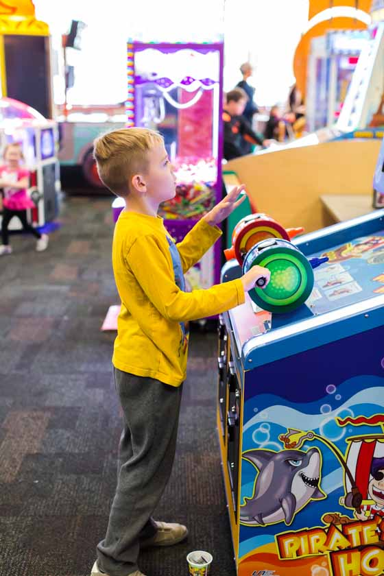 kids playing games at Chuck E. Cheese's
