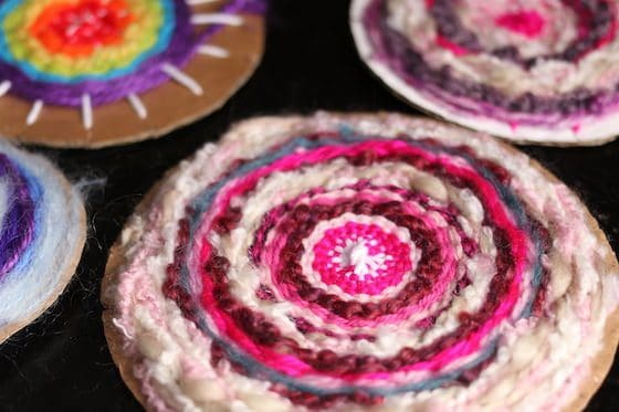 Close up circle weaving in pink yarns