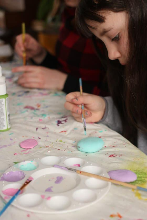 Kids painting stones in Easter colours