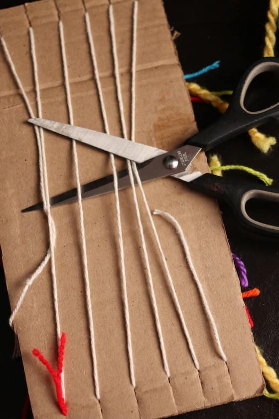 cutting strings weaving loom