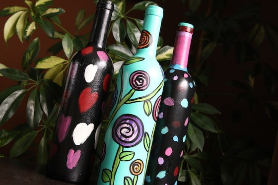 3 painted wine bottles
