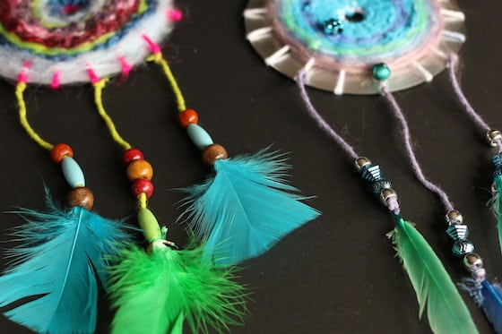 Closeup feathers and beads on CD dreamcatchers