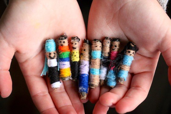 HandMade Worry Dolls in child's cupped hands