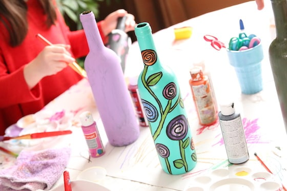 kids painting wine bottles for Mother's Day Gift