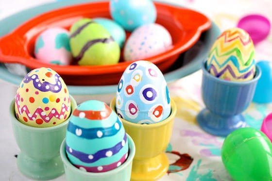 painted eggs in egg cups