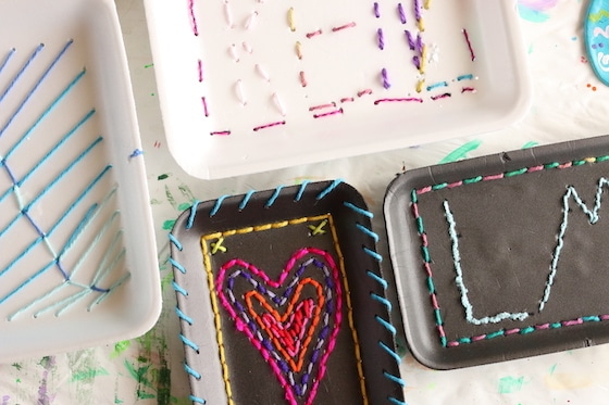 Various designs stitched on styrofoam produce trays by kids - heart, initials, names etc.