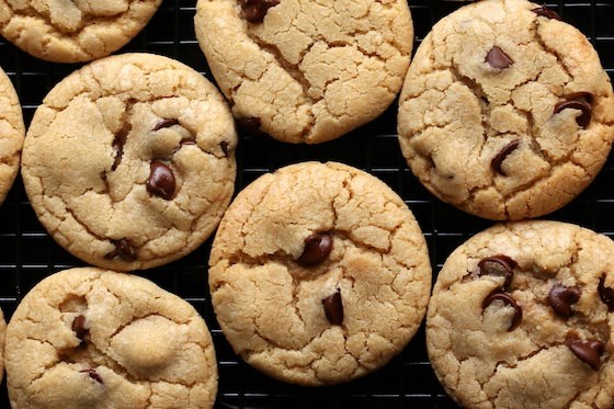 Close up chocolate chip cookies on baking rack