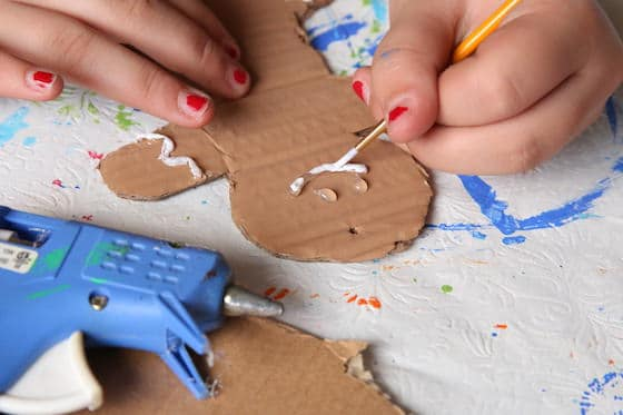 painting mouth on gingerbread man