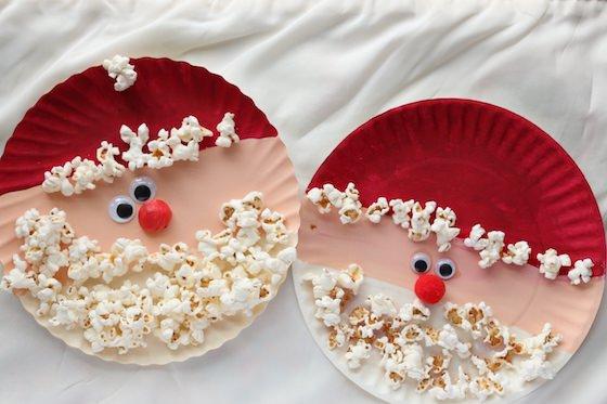 2 paper plate popcorn santas on cream backdrop