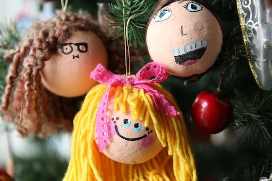 3 ornaments with yarn hair painted to look like little girls