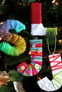 yarn wrapped initial ornaments on Christmas tree - feature image