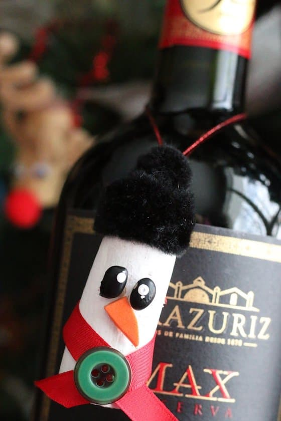 Cork Snowman Ornament hanging around neck of bottle of wine