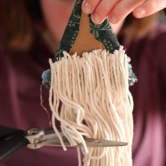 kid cutting yarn for gnome beard