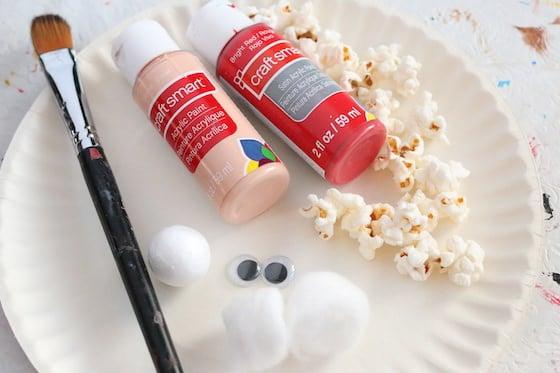 Paper Plate, paint brush, paint, popcorn, googly eyes