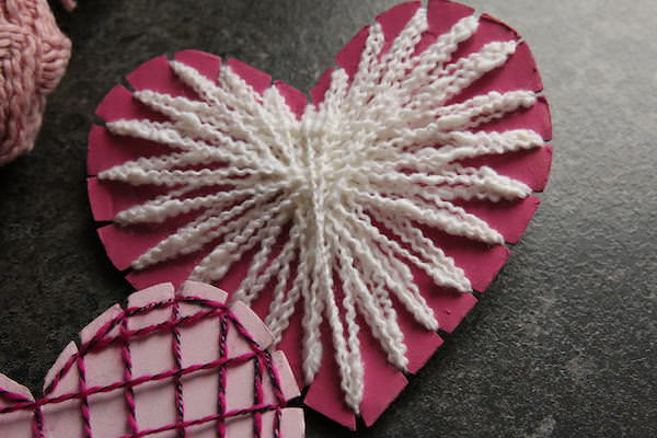Pink cardboard heart with white string
