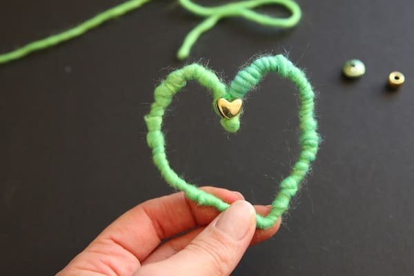 green heart with gold bead