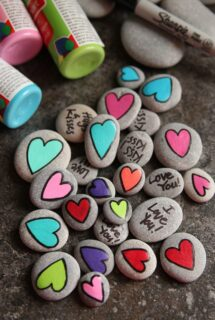Homemade Painted Heart Worry Stones for Kids with hearts and messages - feature image