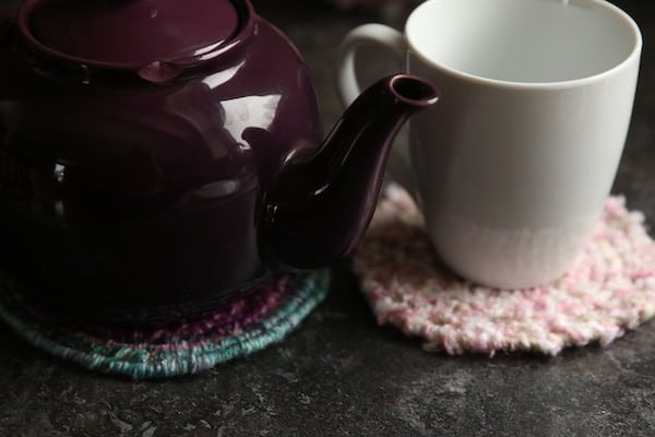 sideview teapot on trivet mug on coaster