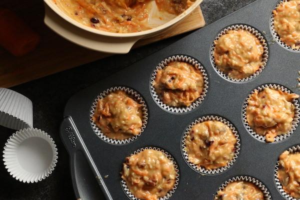 morning glory muffin batter in muffin tin