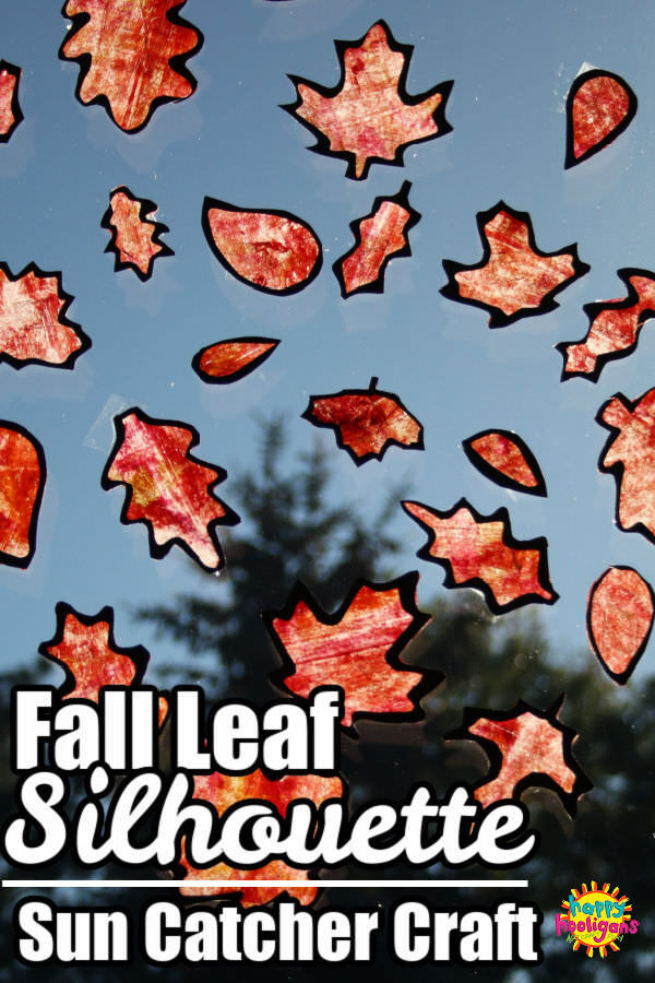 Fall Leaf Silhouettes with painted orange wax paper illuminated by sunshine in window