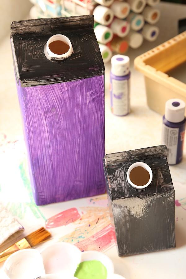 milk cartons painted black and purple