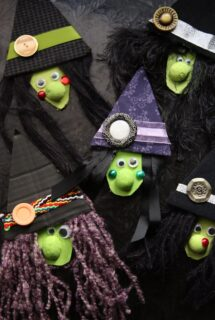 Fabric and cardboard Witch Faces on black backdrop
