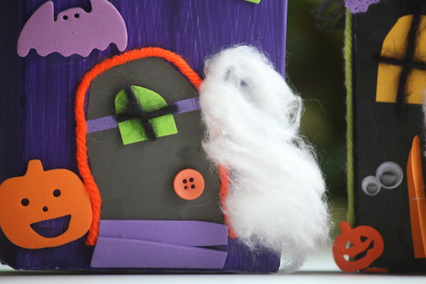 cotton ball ghost at front door of haunted house