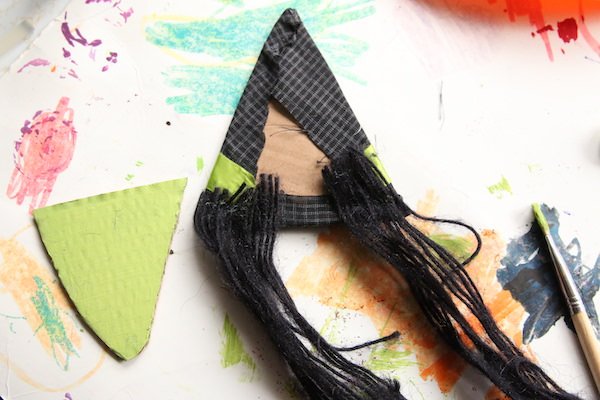 gluing hair on back of witch hat