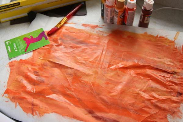 orange paint on wax paper