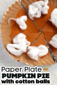 Paper plate pumpkin pie with puffy paint filling and cotton ball topping