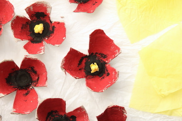 Egg carton poppies and yellow squares of tissue paper