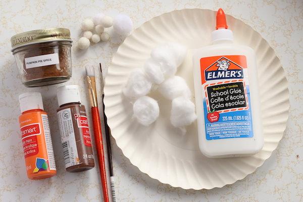 paper plate, glue, cotton balls, pom poms, paint, brushes, pumpkin pie spice