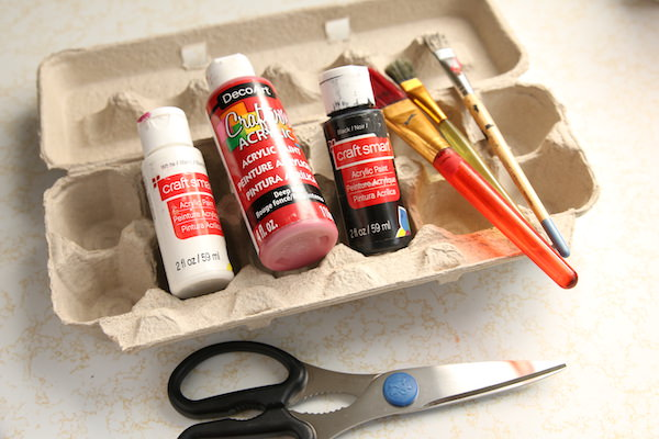 egg carton, red and black paint, paintbrushes, scissors