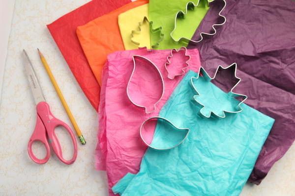 tissue paper, leaf cookie cutters, scissors