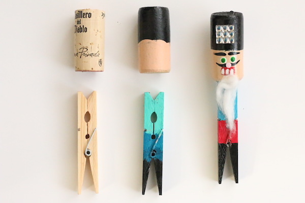 unpainted cork and clothespin beside finished painted nutcracker