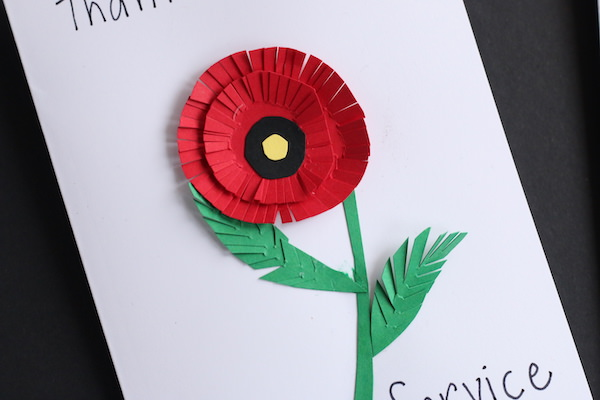 paper circle poppy with fringed edges on petals and leaves