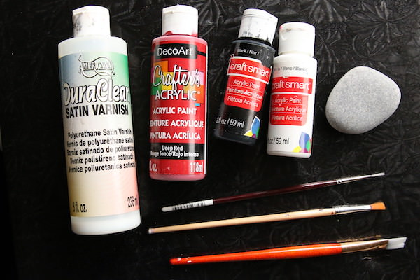 Supplies for Poppy Rocks - paint, brushes, smooth beach stone