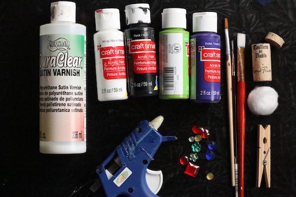 acrylic paints, varnish, glue gun, cork, cotton ball, clothespin