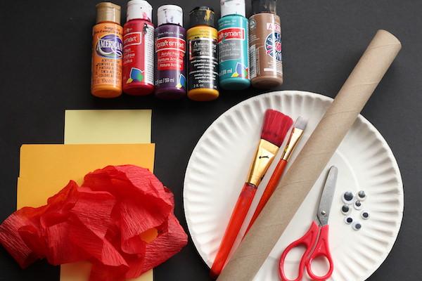 paper plate, paints, brushes, cardboard roll, crepe paper, scissors, google eyes