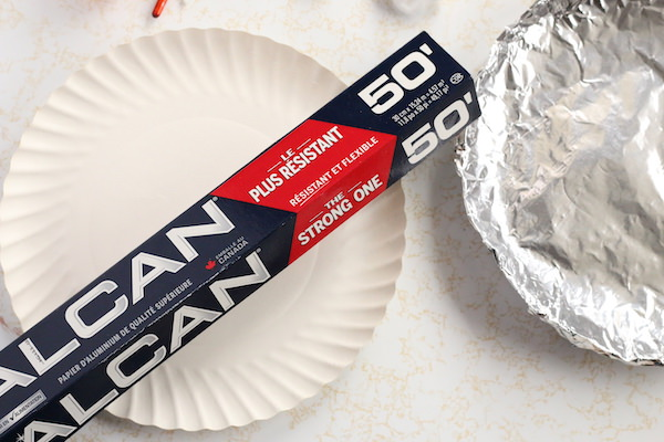 tin foil wrapped paper plate beside roll of tin foil