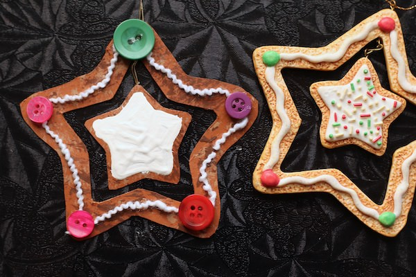 painted cardboard star with yarn and buttons glued on