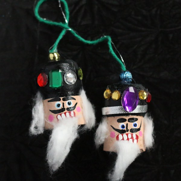 two nutcracker cork heads attached with string