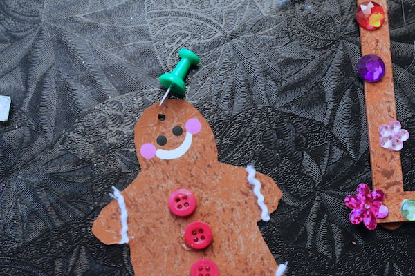 poking hole in gingerbread man with thumbtack