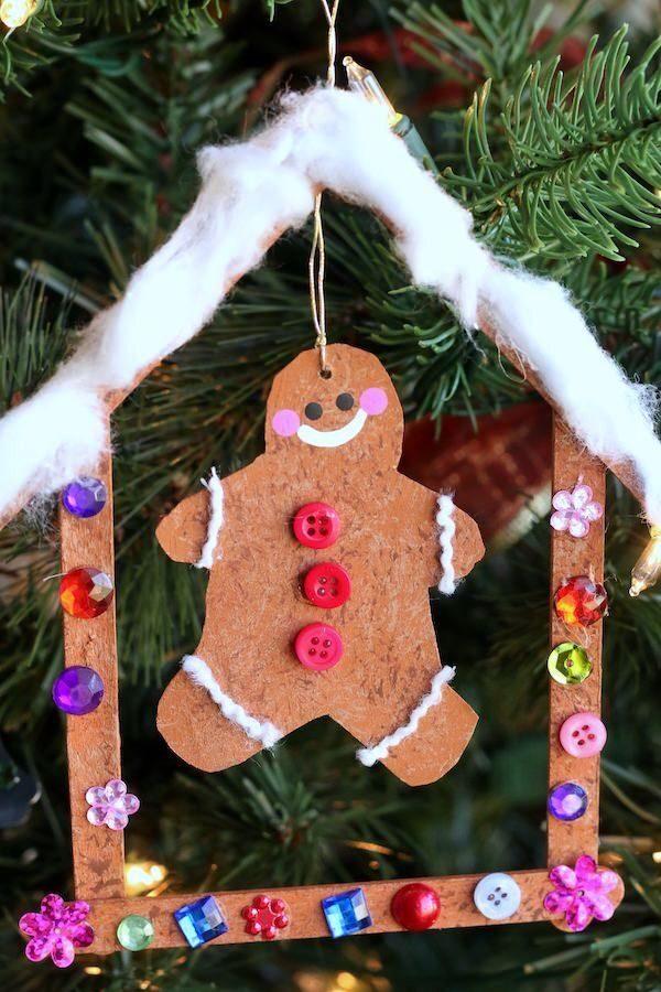 cardboard gingerbread man in craft stick gingerbread house ornament
